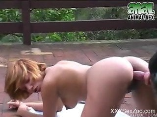 Green bikini blonde gets on all fours to fuck a horny dog
