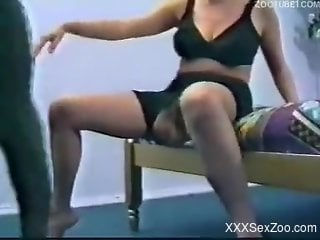 Brunette in black crotchless get-up gets fucked by a dog