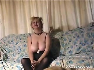Fat MILF with a collar sucking a dog's massive cock