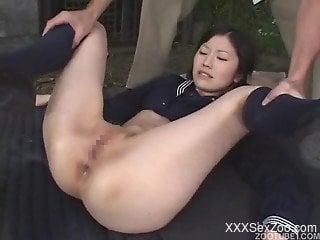 Cuffed Asian model sucks a tasty doggy dick
