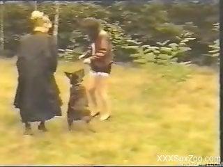 Horny dog fucks two women in insane home video