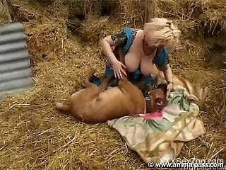 Farm MILF with big boobs sucks her doggy in the hayloft