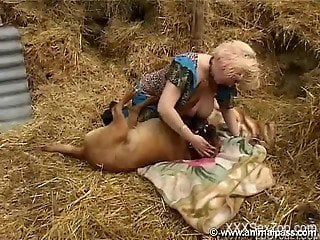 Sensual mature blonde fucks with a big trained doggy at the ha...