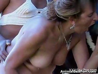 Busty blonde sucking a stallion's massive cock