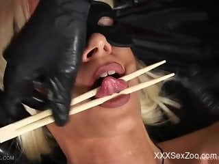 Blonde getting tortured by her weird mistress