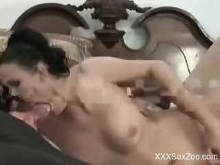 Brunette woman loves the taste of dog cock in her mouth